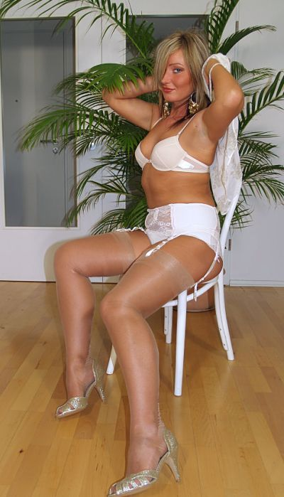 white silk push-up bra, embroidered bikini bottom and sheer nylon stockings